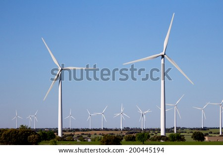 wind energy park in the field - stock photo