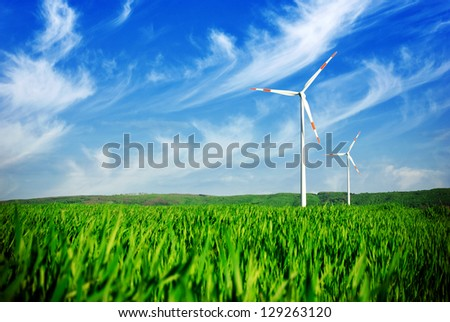 Wind energy turbines on the field - stock photo