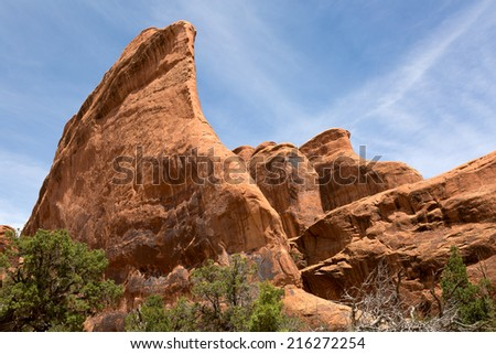 wind eroded sandstone red rock cliffs in Arches National Park Utah - stock photo