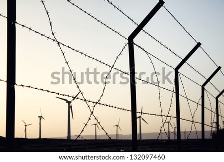 Wind farm after sunset - stock photo