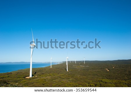 Wind farm along coast of Southern Ocean in Western Australia, supplying renewable clean energy to town of Albany, summer sunny blue sky, copy space. - stock photo