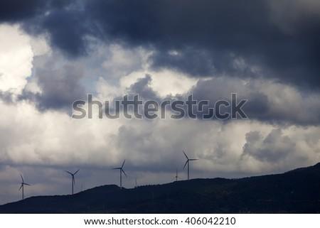 Wind farm and cloudy sky before storm. Turkey, coast of Marmara.  - stock photo