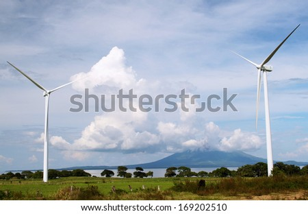 Wind Farm and Ometepe Island Volcano at Lake Nicaragua  - stock photo
