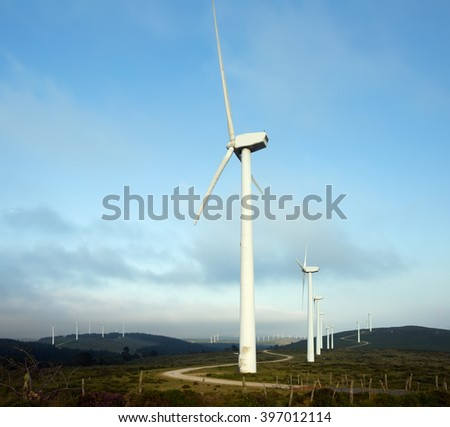 Wind farm at hills in summer.   Spain