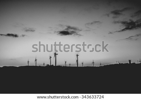 wind farm black and white long exposure