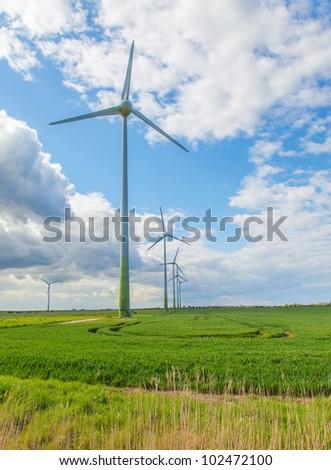 Wind farm in a  green field - stock photo