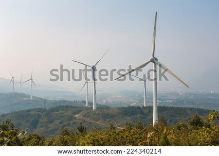 wind farm - new energy in fog and haze   - stock photo