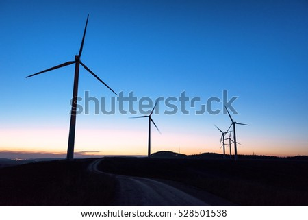 Wind farm silhouette at dusk