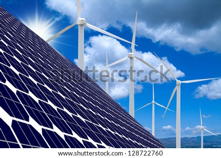 Wind farm,solar panels, blue sky and clouds - stock photo