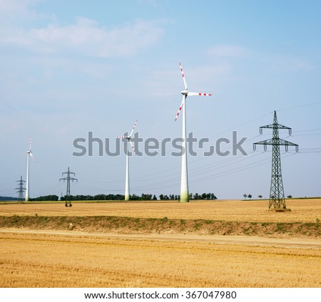 Wind farms on field - stock photo