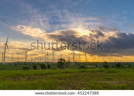 Wind farms silhouette at sunset