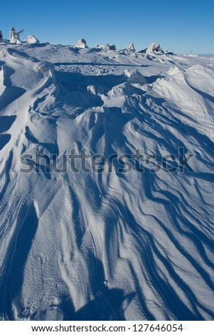 Wind formation on snow in winter mountains - stock photo