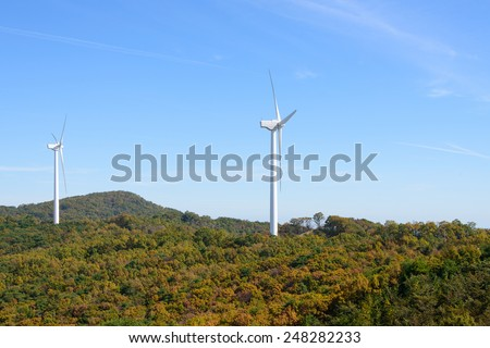 wind generator in a mountain with autumn colors