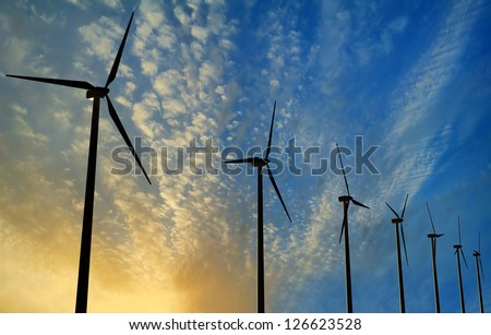Wind Generator Turbines on Sunset - Green Renewable Energy - stock photo