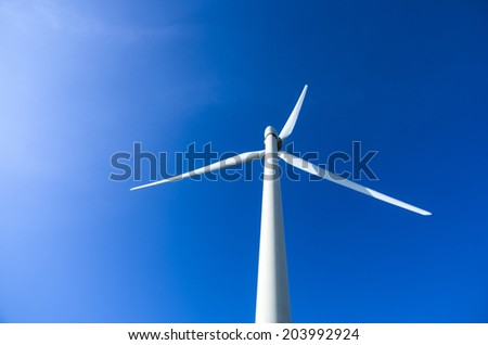 Wind Generator Turbines over Blue Sky. Green Renewable Energy.