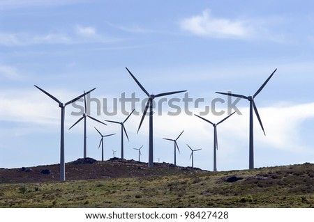 Wind generators against a beautiful blue sky. - stock photo
