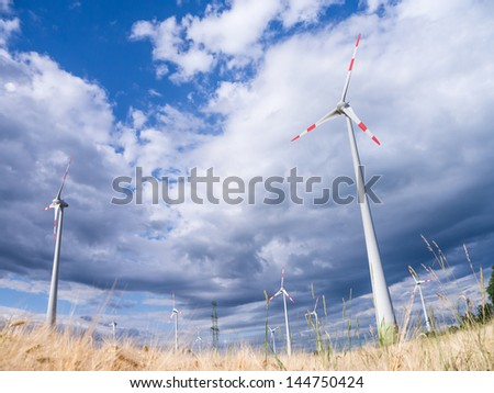 wind generators and a wheat field - stock photo