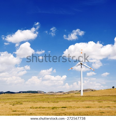 wind generators turbine and blue sky with clouds - ecology energy saving concept - stock photo