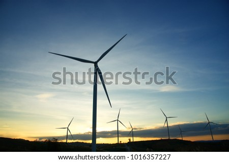 Wind generators turbines at sunset : Khao Kho mountain, Thailand. Renewable energy concept.