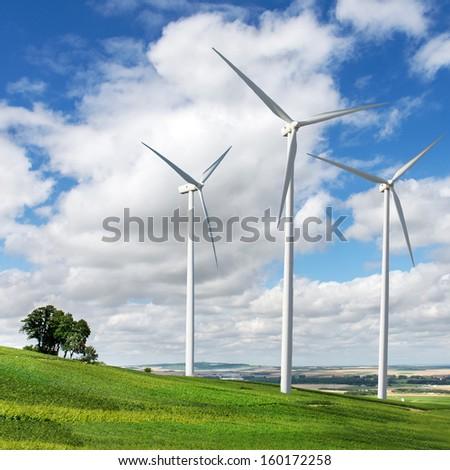 Wind generators turbines on summer landscape - stock photo