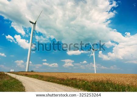 Wind generators turbines on wheat field in Romania - stock photo