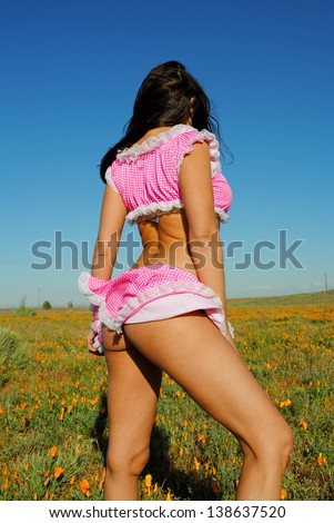 wind lifting a lady's skirt - stock photo