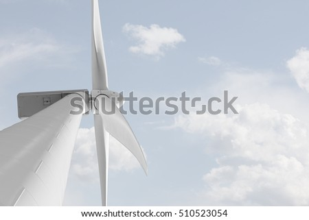 Wind mill against smooth cloudy sky with copyspace - renewable energy production with wind generator modern technology to produce eletricity with the power of wind