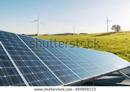 Wind mill and photovoltaic solar cell collage - Ecology and green energy collage