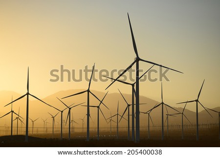wind mill farm in california desert - stock photo