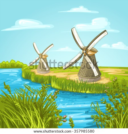 Wind mill near a blue canal on a summer day - stock photo