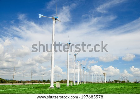 Wind mill power plant against blue sky - stock photo