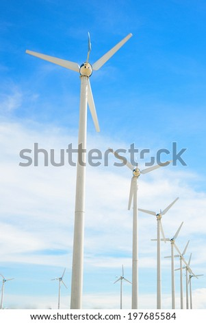 Wind mill power plant against blue sky