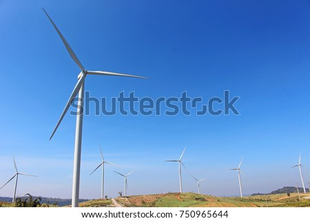 Wind mill turbine on the top of mountain in blue sky, the natural generator energy. From petchaboon