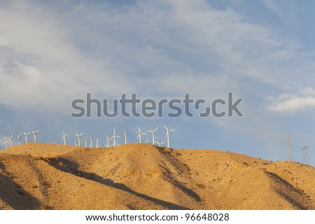 Wind Mill turbines on top of mountain range, Palm Spring, CA - stock photo