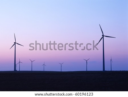 Wind mills generate electricity as an alternative to the use of fossil fuels.