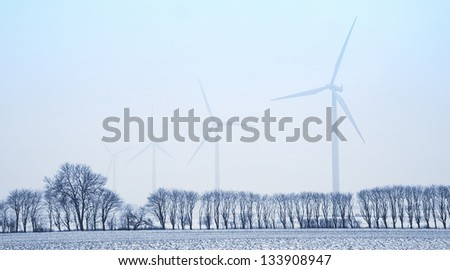 Wind mills in the landscape at wintertime.