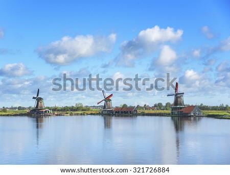 Wind mills of Zaanse Schans, a village in the Netherlands. - stock photo
