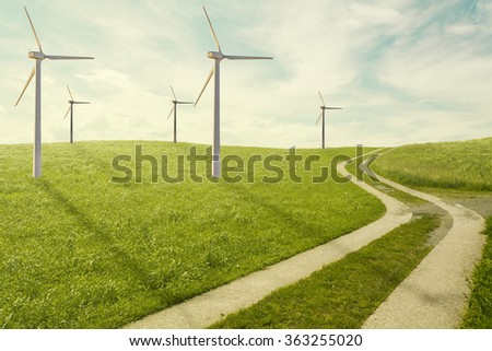 Wind mills power plants alternative energy - symbolic path for the right way in ecologic and natural power source - stock photo