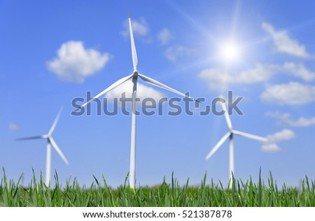 Wind power energy. Green field and wind turbines generating electricity.