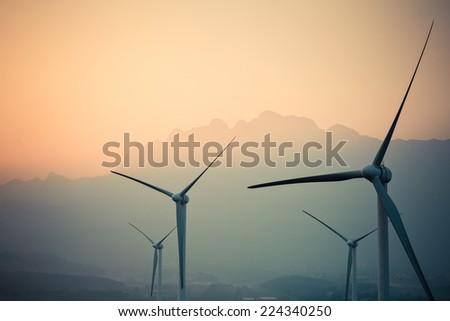 wind power generation turbine closeup at dusk ,new energy in jiangxi lushan  - stock photo
