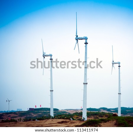 Wind power generator, in the desert area of China, environmental energy equipment. - stock photo