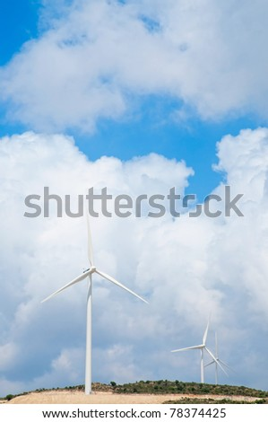 Wind power generators  against blue sky