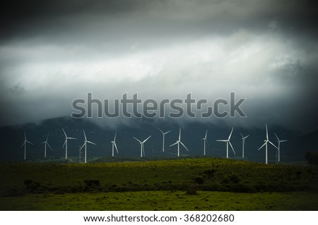 Wind power generators on the storm - stock photo