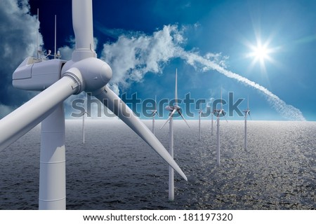 Wind power offshore with clouds and sun - stock photo
