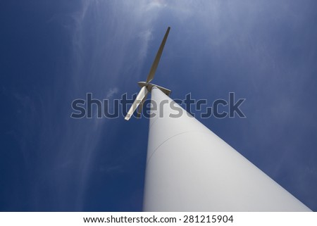 wind power plant against the blue sky - stock photo