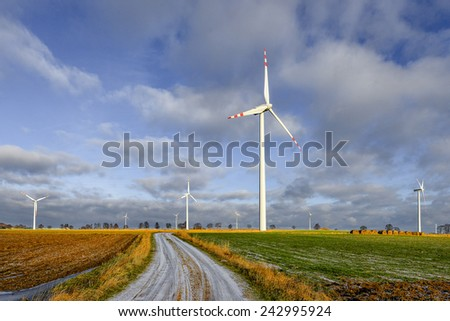 Wind power plant in the fieds - stock photo
