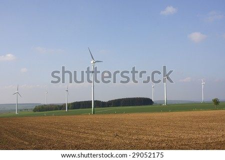 wind power plants on nice spring day
