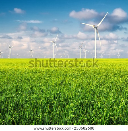 Wind power station on field. Ecological energy concept - stock photo