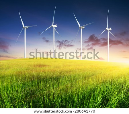 Wind power station on green field. Electrical technology - stock photo