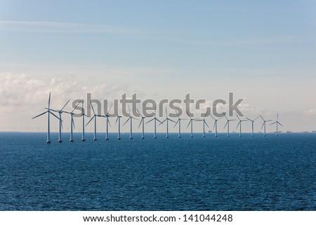 Wind power station on the sea near to coast of Denmark - stock photo